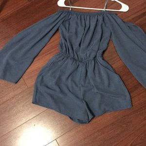 Cute romper with cut off on the sleeves